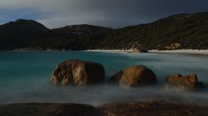 two-people-bay-rocks-by-sea_1200